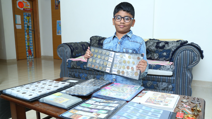 10-year-old expat student in Oman collects 500 coins from 120 countries