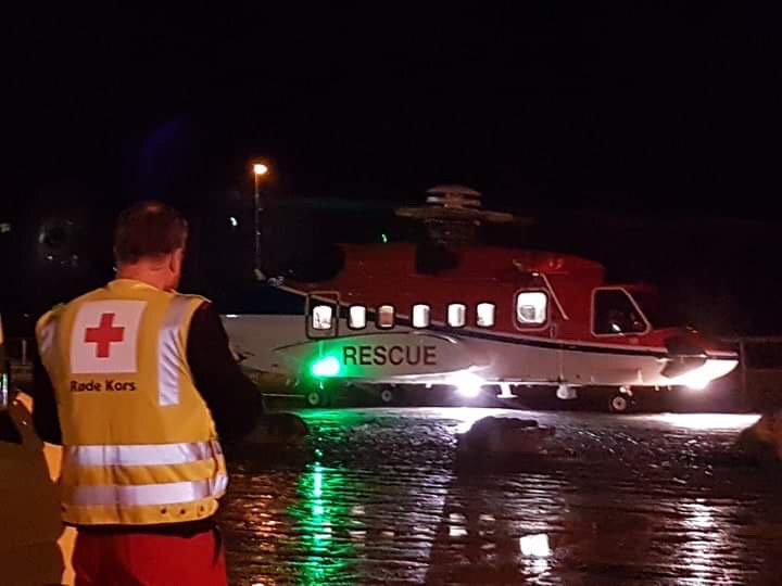 Rescuers work to evacuate over 1,300 passengers from cruise ship