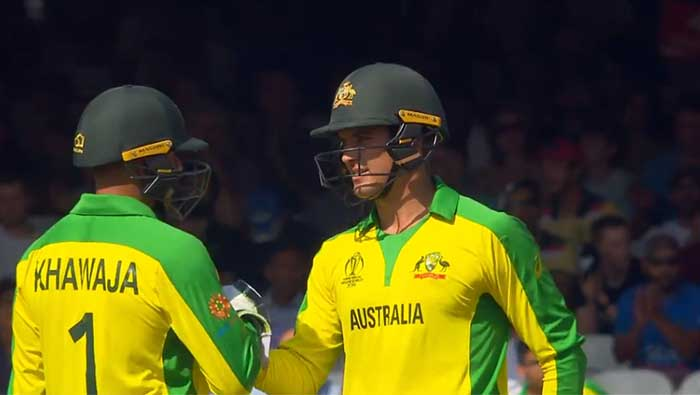Carey and Khawaja half-centuries, Starc five-for help Australia stay at the top