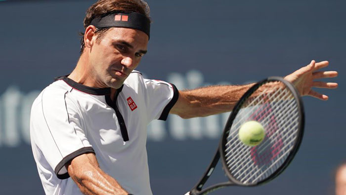 Swiss great Federer into US Open fourth round