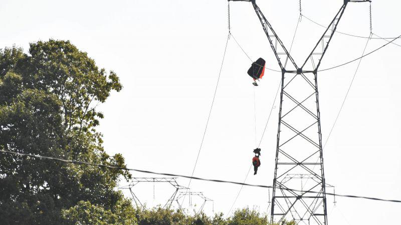 Belgian F16 pilot stuck in power cables after plane crash