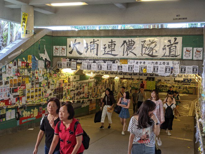 Pro-China supporters pull down 'Lennon Walls' in Hong Kong