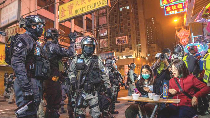 Cops use batons to disperse protesters in Hong Kong