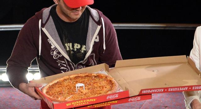عامل توصيل بيتزا مصاب بكورونا يجبر 72 أسرة على الحجر الصحي في الهند