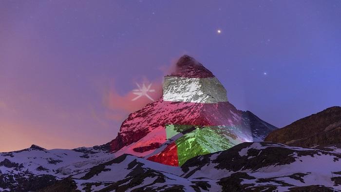 Oman flag displayed on Matterhorn in Switzerland