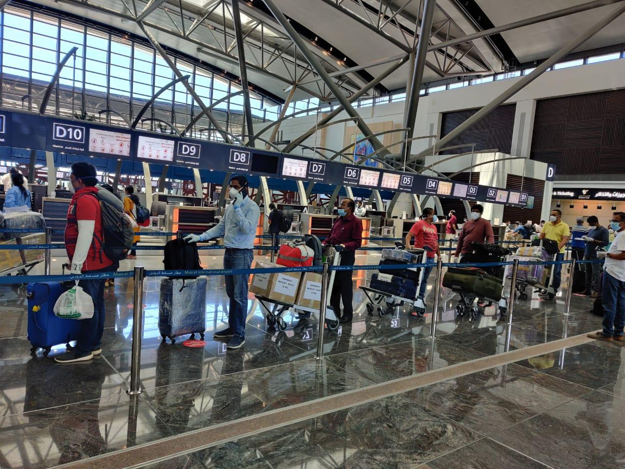 Omani, Indian expats return home on evacuation flights
