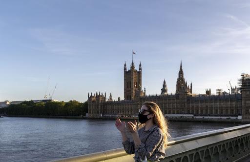 UK relaxes 2-meter social distancing rule to further ease coronavirus lockdown