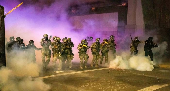 US federal officers use tear gas in fresh confrontation with protesters