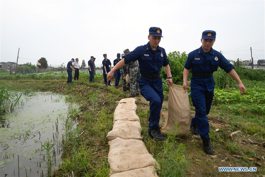 China raises emergency response level as flooding continues