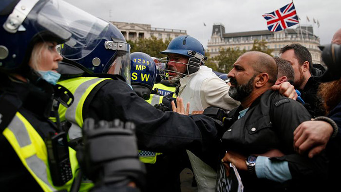 Protesters clash with police at London anti-lockdown restrictions