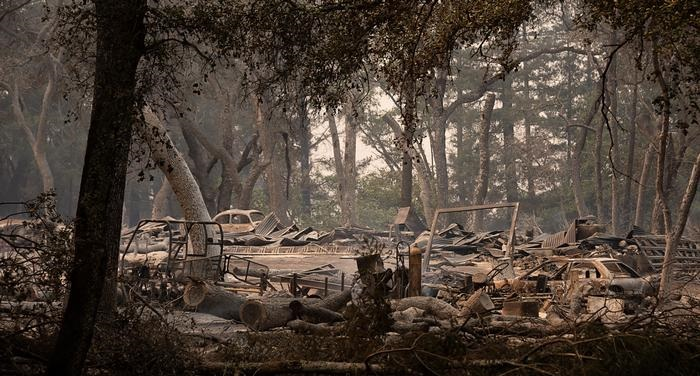 California wildfires kill 3, force tens of thousands to evacuate