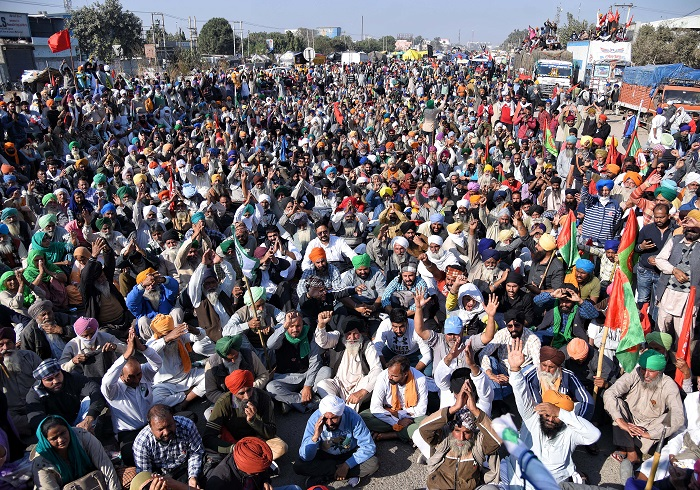 Indian farmers gather at Delhi's Burari Ground amid massive protests