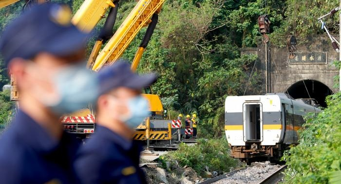 Taiwan mourns after deadliest train crash in decades
