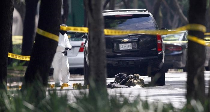 18 dead after shootout between rival drug cartels in Mexico