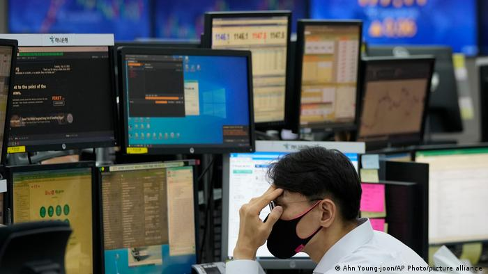Global stocks hit by COVID resurgence fears