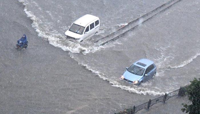 Record rains in central China cause massive disruptions
