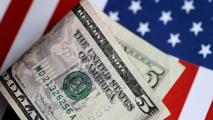 Dollar hits four-month high against euro on Fed taper talk