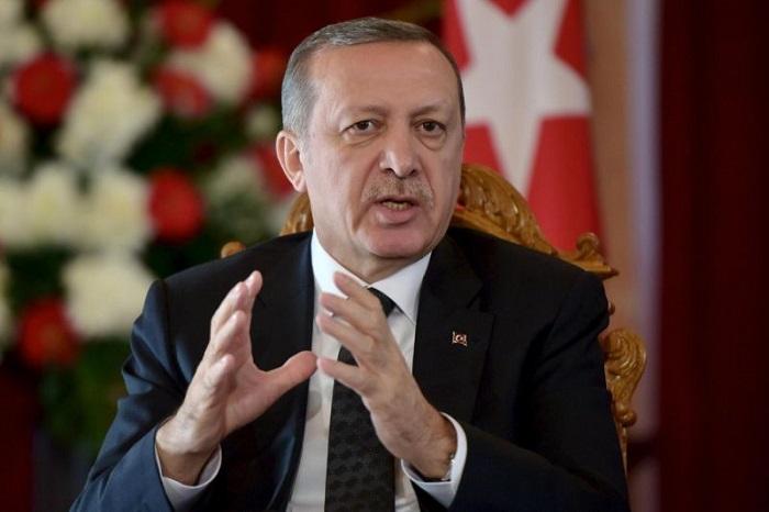 Turkey won't become Europe's 'refugee warhouse', warns Erdogan as Afghans flee Taliban