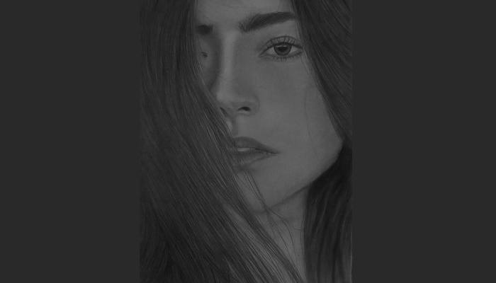 Pencil in hand, she captures emotions on a sheet of paper